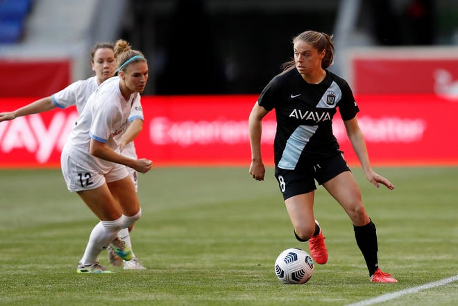 Gotham FC defender Erica Skroski (8) moves the ball while Houston Dash forward Veronica Latsko (12) runs in to defend during the first half of an NWSL soccer match, Saturday, May 15, 2021, in Harrison, N.J. Gotham FC won 1-0. (AP Photo/Steve Luciano)