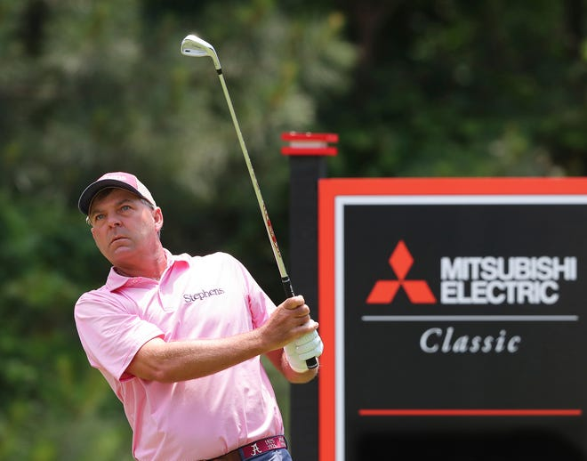 Dicky Pride tees off on the 11th hole during the final round of the PGA Tour Champions' Mitsubishi Electric Classic golf tournament at TPC Sugarloaf on Sunday, May 16, 2021, in Duluth, Georgia. (Curtis Compton/Atlanta Journal-Constitution via AP)