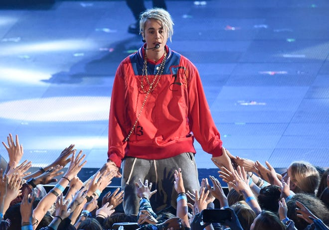 """Justin Bieber performs """"Love Yourself"""" and """"Company"""" during the iHeartRadio Music Awards at The Forum on Sunday, April 3, 2016, in Inglewood, Calif."""