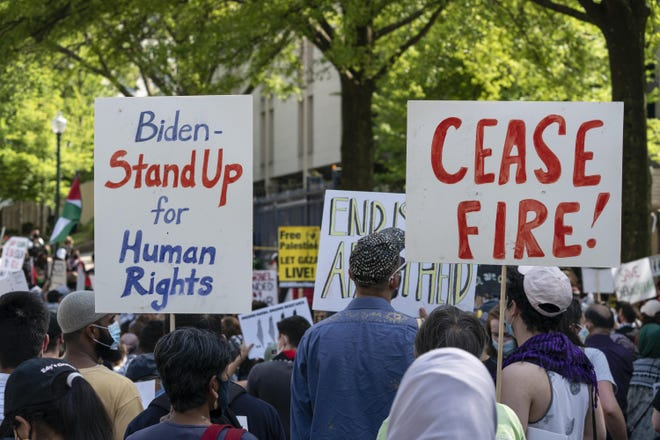 Protesters hold signs as they gather in front of the Israeli embassy to protest the Middle East war between Israelis and Palestinians, Tuesday, May 18, 2021, in Washington. (AP Photo/Alex Brandon)