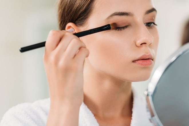 Experts say it's OK to use makeup to cover up your blemishes, but make sure to properly take it off before going to bed.