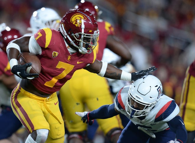 Southern California running back Stephen Carr (7) runs the ball against Arizona safety Christian Young (5) at the Los Angeles Memorial Coliseum in this 2019 file photo. Carr announced Sunday that he is transferring to Indiana. (Gary A. Vasquez / USA TODAY Sports)