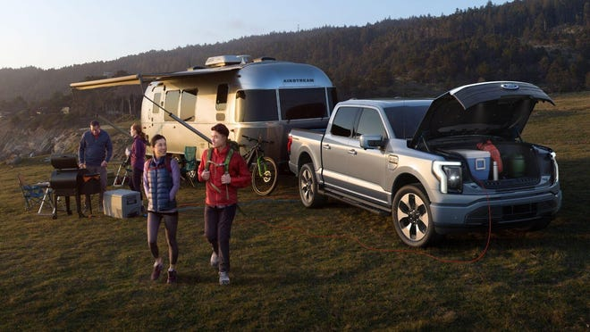 With up to 10,000 pounds of towing capacity and a 14.1 cubic-foot front trunk, the 2022 Ford F-150 Lightning is a new electric pickup offering up to 300 miles of driving range. (Ford Motor Company)