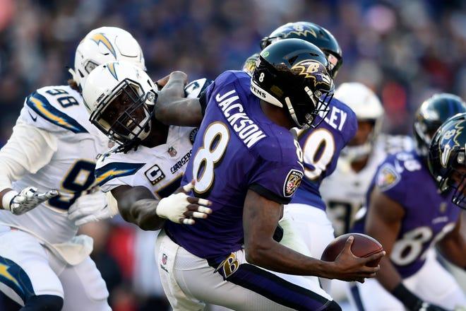 The Chargers' Melvin Ingram sacks Ravens quarterback Lamar Jackson.