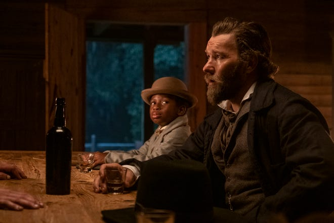 """Ridgeway (Joel Edgerton), right, and his sidekick, Homer (Chase Dillon), spend the series chasing Cora in """"The Underground Railroad."""""""