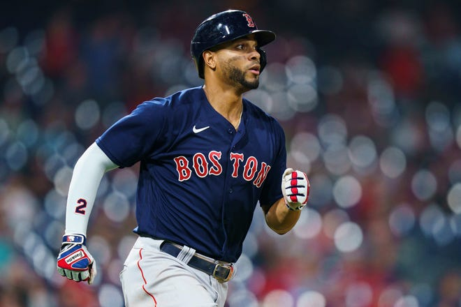 Boston Red Sox's Xander Bogaerts runs the bases after hitting home run during the sixth inning of the team's baseball game against the Philadelphia Phillies, Saturday, May 22, 2021, in Philadelphia. (AP Photo/Chris Szagola)