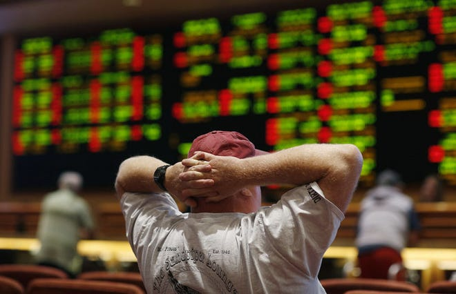 A man watches a baseball game in the sports book at the South Point hotel-casino, Monday, May 14, 2018, in Las Vegas. The Supreme Court on Monday gave its go-ahead for states to allow gambling on sports across the nation, striking down a federal law that barred betting on football, basketball, baseball and other sports in most states. (AP Photo/John Locher)