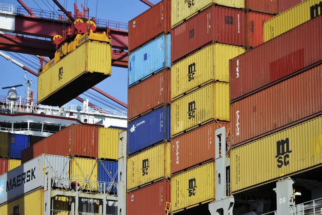 A container is loaded onto a cargo ship at a port in Qingdao in east China's Shandong province.