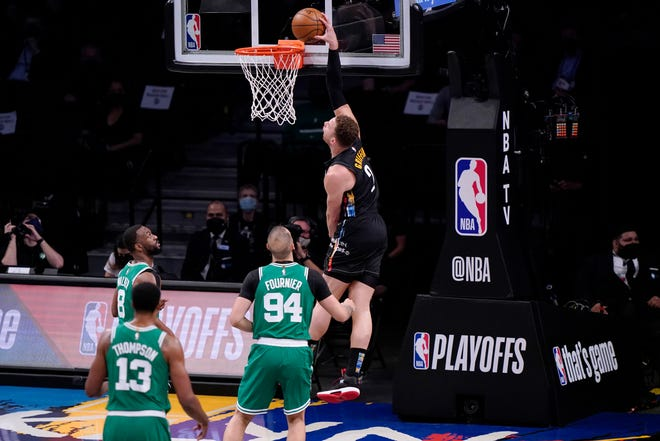 Brooklyn Nets forward Blake Griffin (2) dunks in front of three Boston Celtics defenders during the first quarter of Game 2 of an NBA basketball first-round playoff series Tuesday, May 25, 2021, in New York. (AP Photo/Kathy Willens)