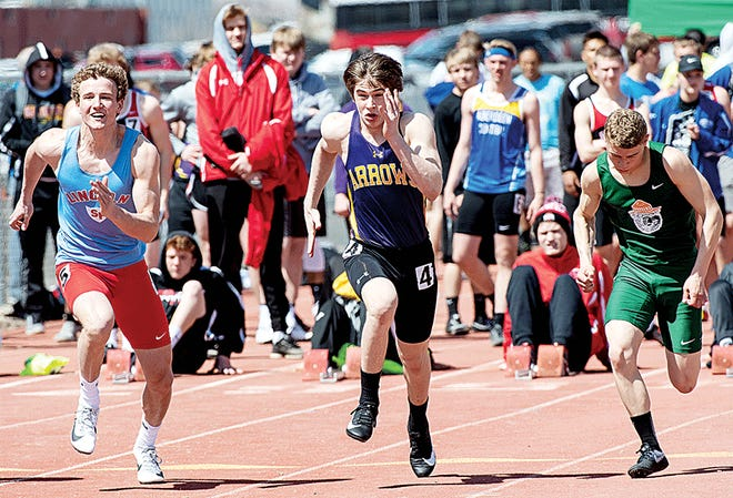 Watertown's Jake Werner (center) sprints toward the finish line during the boys' 100-meter dash prelims Thursday in the American Legion Track and Field Meet at Pierre. Werner qualified for the finals in the event and placed seventh. (Photo by Bob Grandpre, For the Pierre Capitol Journal)