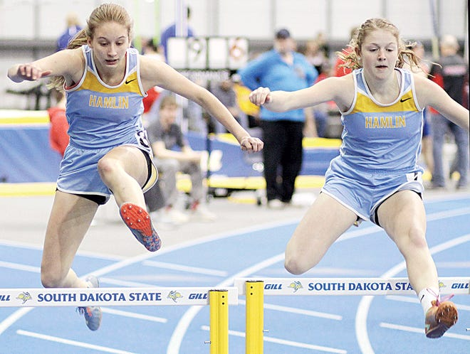 Hamlin's Gabby Mischke (left) and Taryn Opdahl head to the finish line during a girls' 300-meter hurdles heat race Monday in the Scott Underwood Indoor Invitational track and field meet at the Sanford-Jackrabbit Athletic Complex in Brookings. Opdahl and Mischke finished 1-2 in the heat. Opdahl placed eighth overall. (Photo by Sean Welsh, Brookings Register)