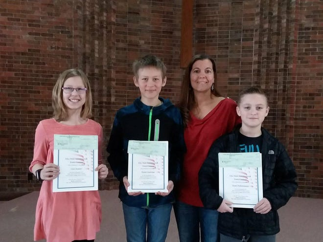 State Elks essay contest winners were announced Friday during chapel at Watertown Christian School. Pictured from left are Claire Kramer, second place winner in the female division; Hessel Andringa, second place winner in the male division, teacher Marcie Wallenmeyer and Noah Wallenmeyer, first place winner in the male division. All were competing in the grades 5-6 level. (Courtesy photo)