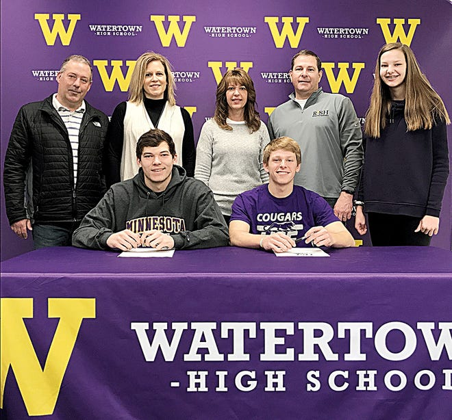Watertown High School seniors Ben DeVille (front left) and Brennan Gabriel (front right) signed to play college baseball on Wednesday — DeVille at Minnesota State Mankato and Gabriel at the University of Sioux Falls. DeVille is a catcher and Gabriel a pitcher-outfielder for the WHS and Watertown Post 17 American Legion baseball teams. Pictured in back, from left, are Ben's parents Todd and Justine DeVille, Brennan's parents Cathy and Dan Gabriel and his sister Addy Gabriel.