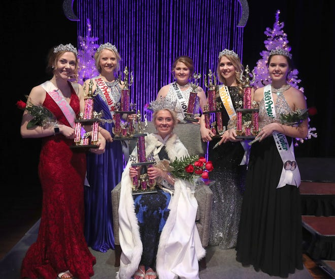 Aleah Steger, Miss Ipswich, seated, was crowned the 2019 South Dakota Snow Queen Saturday night at the Aberdeen Civic Theater. Members of her court include from the left: Princess of Summer, Emma Greiner, Miss Wilmot; Princess of Autumn, Samantha Olson, Miss Northwestern; Miss Congeniality, Kayla Sautner, Miss Hoven; Princess of Spring, Anna Schwader, Miss Miner County and Princess of Winter, Elise Herschel, Miss Sisseton. American News photo by John Davis taken 1/12/2019