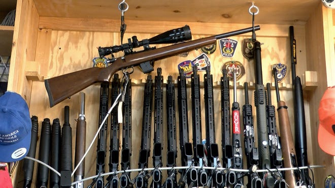 A rack of rifles are shown inside a New Jersey gun shop in July 2020. A two-year set of Alcohol, Tobacco, Firearms and Explosives records found many of the weapons dealers recommended to lose their licenses instead kept them. The New Jersey shop was not cited in the records reviewed by reporters.