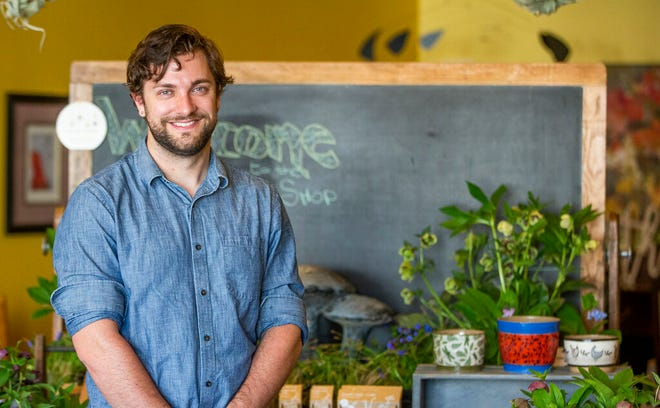 Ben Futa stands in his new pop-up garden shop, Botany, in the dining room at Thyme of Grace restaurant Tuesday, in South Bend.