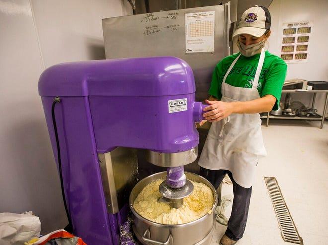 Robbie Berg prepares paczki dough Thursday at Jack's Donuts in Mishawaka.
