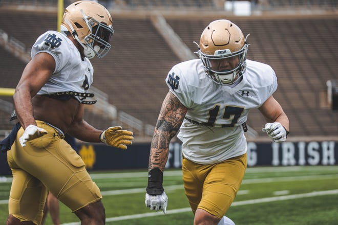 Sophomore defensive end Jordan Botelho (17), who recently changed to No. 12, is set to make his season debut for Notre Dame on Saturday.