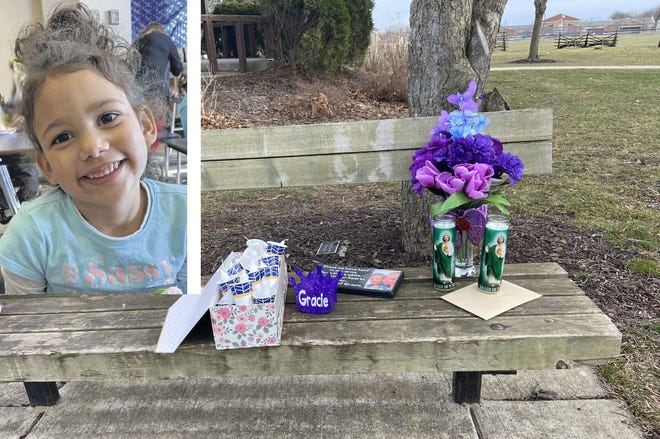 Flowers and candles are placed on a bench at Memorial Park in New Carlisle in honor of Grace Ross, the 6-year-old girl whose body was found in March.