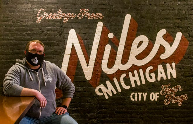In this December 2020 Tribune file photo, Niles Brewing Company owner Brandon Townsley sits inside his new small-batch brewery.