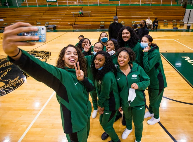 Mila Reynolds takes a selfie with her teammates during the media night event for the Washington girls basketball team Wednesday at the high school.