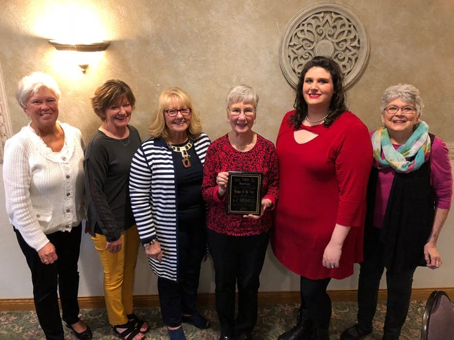 From left, Beta Sigma Phi City Council members Nancy Iverson, Lola Sackeiter and Jean Doyen, Woman of the Year award winner A.J. Sherrill, Oriel Ching of the Beacon Center and council member Barb Erickson pose for a photo at the annual Beta Sigma Phi Founder's Day event. (Courtesy photo)