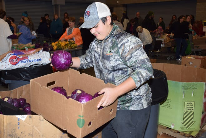 Members of First United Methodist Church and Feeding South Dakota helped hand out food during a food giveaway Wednesday evening at the Ernie Edwards Readiness Center in Watertown.(Public Opinion photo by Rich Remmers)