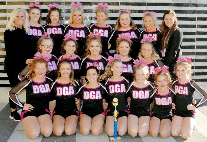 The Dakota Gold Magic cheer squad placed first in the Senior Level 2 division over the weekend in the Champion Crown Cup at Harrisburg. Team members include, from left in front, Abbi Cummings, Courtney Hanson, Shayne Gallardo, Jade DeYoung, NoelleMack, Kayla Bentley and Erika Stadheim; middle, Grace Jurgens, Dezi Briggs, Kelsey O'Farrell, Olivia Weber and Dacey Veflin; and back, coach Renee Cummings, Elise Thorson, Lisa Pahl, Madison Coester, Theresa Christians, HannahDargatz, Anni Cummings and coach Alli Cummings. (Courtesy photo)