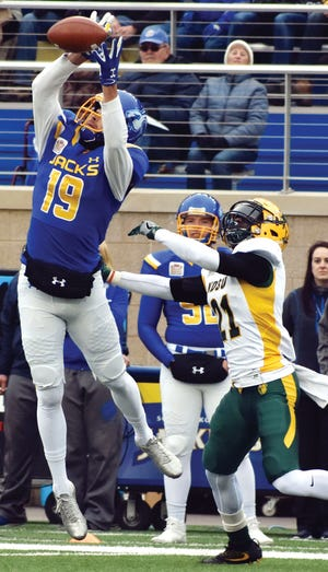 South Dakota State receiver Jake Wieneke grabs a pass in front of North Dakota State cornerback Jalen Allison on Saturday during a Missouri Valley Football Conference game at Dana J. Dykhouse Stadium in Brookings. The Jackrabbits defeated second-ranked NDSU 33-21 in the annual Dakota Marker game. (Photo by Abby Fullenkamp, Jackrabbit Sports Service)