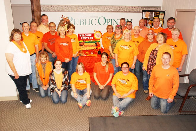 """WatertownPublic Opinion employees sport their orange attire for a group photo.The Public Opinion won the """"Top Employee Involvement"""" award in October as part of the South Dakota Rooster Rush """"Paint the Town Orange"""" contest. (Public Opinion photoby J.T. Fey)"""