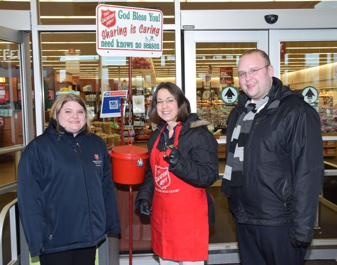 Watertown Mayor Sarah Caron, middle, joined Salvation Army's Karissa Zumwalt, left, and Zac Zumwalt at Hy-Vee Friday afternoon to ring the bells and raise funds for the Salvation Army's Red Kettle program. (Public Opinion photo by Rich Remmers)