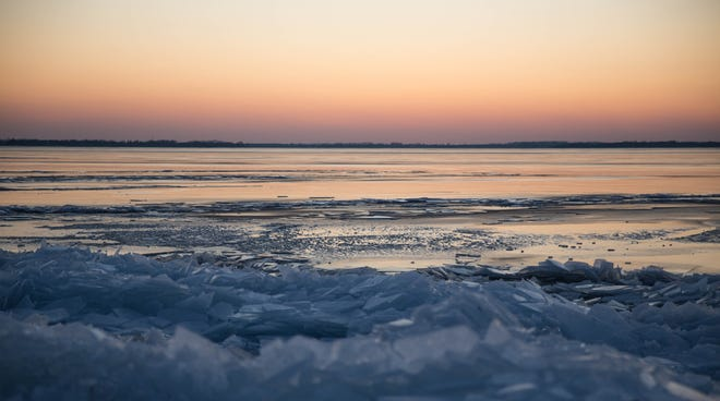 Sheets of ice cover the shore of City Park on Saturday as the sun sets on Lake Kampeska. (Public Opinion photo by Grace Ramey)