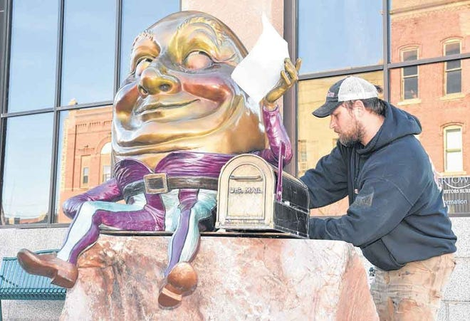 New sculptures will be installed for the ArtWalk in downtown Watertown on May 4. Meanwhile, on Friday crews were removing the old ones. Josh Craig of #1 Welding works to free Humpty Dumpty from his perch.