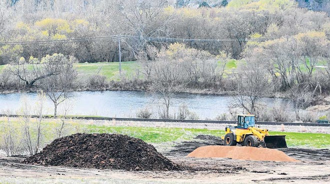 Work on the expansion of an existing retention pond is done at the bottom of St. Ann's Hill west of Prairie Lakes Healthcare System as part of the current Prairie Lakes Specialty Clinic building project. The new clinic space is scheduled to open in the fall of 2018. The city-owned Kiddie Pond is seen in the distance.
