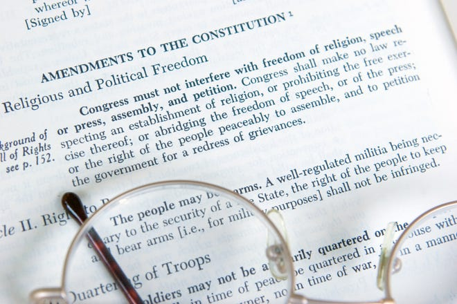 The First Amendment to the Constitution is shown on the page of a history book. (Jim Knopf, Adobe Stock)