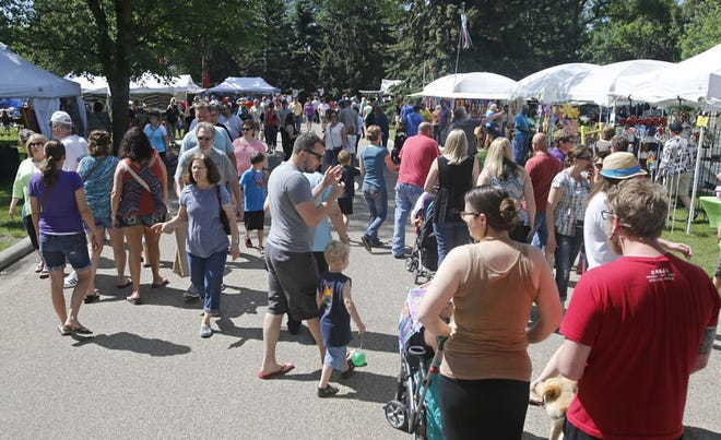 Aberdeen's Arts in the Park has drawn large crowds to Melgaard Park in previous years. After a one-year absence, booths will once again fill the park Saturday and Sunday. American News file photo
