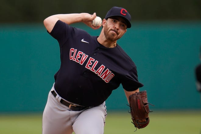 Cleveland pitcher Aaron Civale throws against the Detroit Tigers in the first inning of a baseball game in Detroit, Tuesday, May 25, 2021. (AP Photo/Paul Sancya)