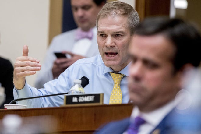 Rep. Jim Jordan, R-Ohio, questions Deputy Attorney General Rod Rosenstein as he and FBI Director Christopher Wray appear before a House Judiciary Committee hearing on Capitol Hill in Washington, Thursday, June 28, 2018, on Justice Department and FBI actions around the 2016 presidential election. (AP Photo/Andrew Harnik)