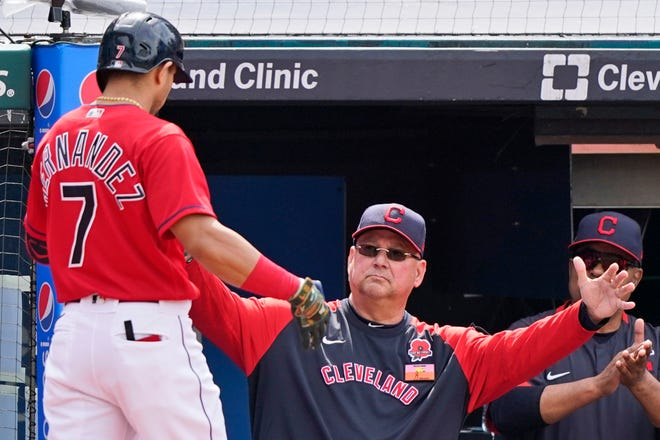 Cleveland manager Terry Francona,  congratulates Cesar Hernandez after Hernandez hit a solo home run in the third inning of the first game of a doubleheader against the Chicago White Sox, Monday, May 31, 2021, in Cleveland. (AP Photo/Tony Dejak)
