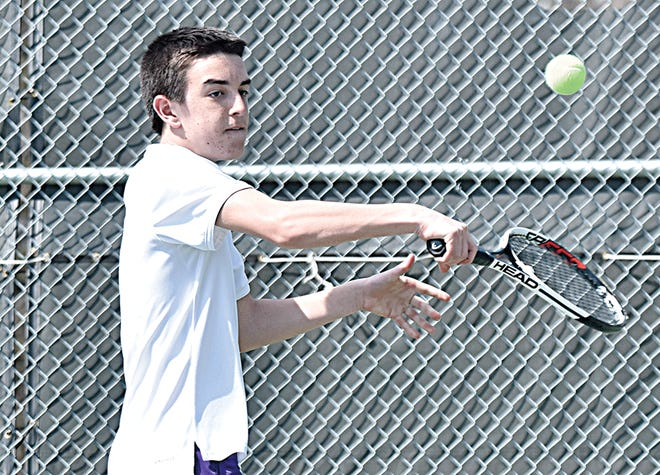 Watertown's Mark Mahowald sends a return shot through the air during a boys tennis dual against Harrisburg on Monday at Highland Park. (Public Opinion photo by Nathan Giese)