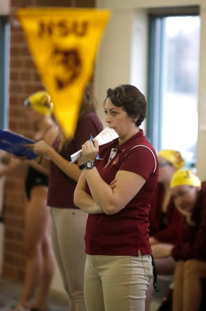 Northern State University swim coach Nicole Monanian watches the action during Saturday's dual with the University of Mary at the Aberdeen Family YMCA. American News Photo by John Davis taken 11/4/2017