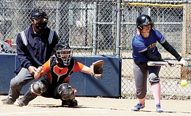 Dakota State's Tatum Ronke, a junior outfielder from Watertown, attempts to lay down a bunt during the Trojans' North Star Athletic Association women's college softball doubleheader Friday in Madison. (Photo by Larry Leeds, Madison Daily Leader)
