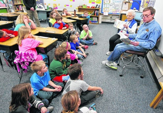 """Aberdeen Mayor Mike Levsen, far right, reads the book """"Effie's Image"""" to a group of second grade students at May Overby School Tuesday. Helping Levsen is Violet Woehl, a member of the Foster Grandparent Program. Levsen read the story to first, second and third graders as part of the Mayor's Day of Recognition for Community Service"""