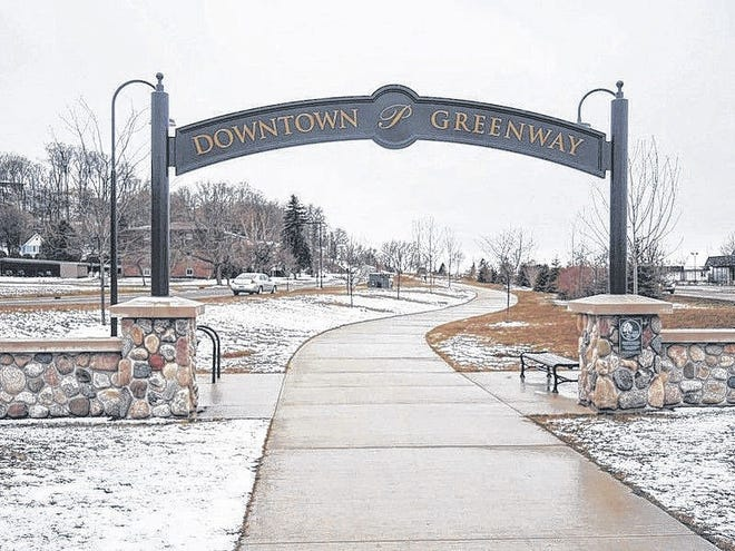 RYAN BENTLEY/NEWS-REVIEW This arch marks the north entrance to Petoskey's Downtown Greenway linear park corridor at MacDonald Drive.