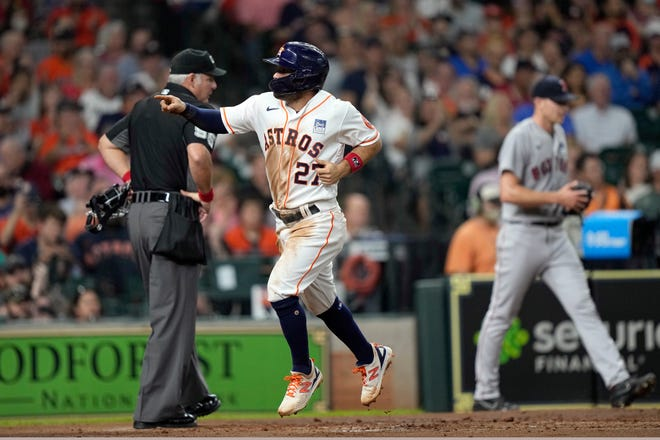 Jose Altuve scored the opening run and the Astros eventually added another in a 2-1 victory over the Red Sox.