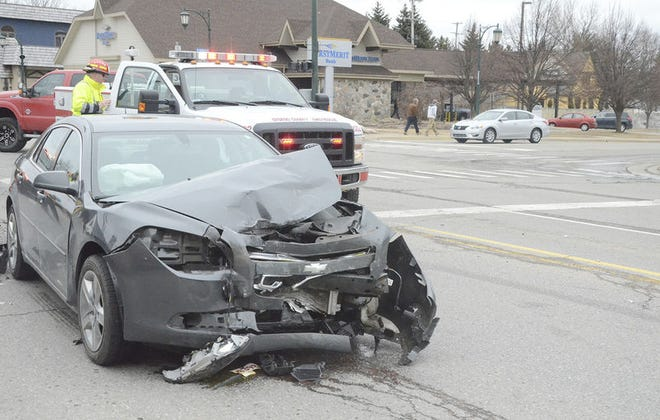 A two-car accident caused when a car making a left turn failed to yield at a green light in Gaylord, Mich. (Mark Johnson/Herald Times)
