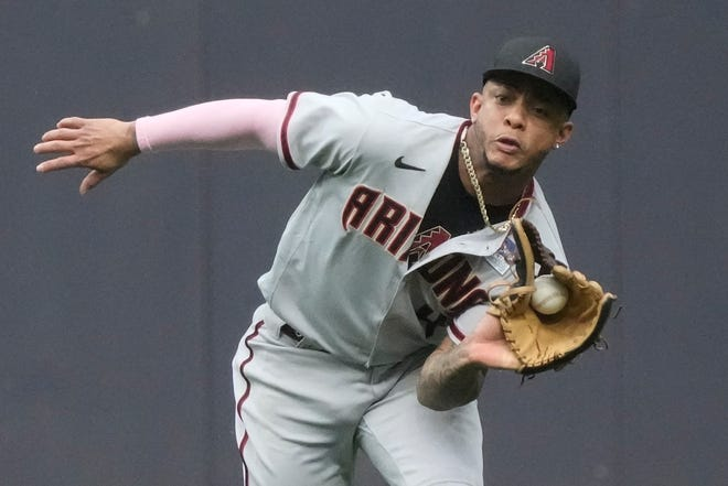 Arizona Diamondbacks' Ketel Marte makes a running catch on a ball hit by Milwaukee Brewers' Avisail Garcia during the third inning of a baseball game Thursday, June 3, 2021, in Milwaukee. (AP Photo/Morry Gash)