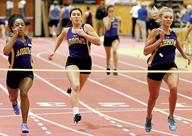 Watertown runners, from left, Ange-Laurette Lear, Megan Fannin and Tava Berg sprint for the tape in their heat of the girls' 55-meter dash during Thursday's indoor track and field dual with Aberdeen Central in the Barnett Center at Aberdeen. Berg later won the 200 dash and the high jump, setting a new school record by clearing 5-6. (Photo by John Davis, Dakota Media Group)