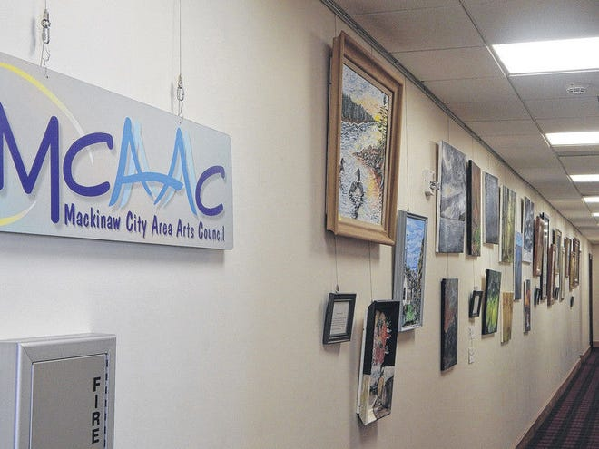 A past exhibit presented by the Mackinaw City Area Arts Council at Pellston Regional Airport is pictured.