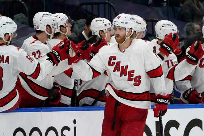 Carolina Hurricanes defenseman Dougie Hamilton (19) celebrates with the bench after his goal against the Tampa Bay Lightning during the second period in Game 4 of an NHL hockey Stanley Cup second-round playoff series Saturday, June 5, 2021, in Tampa, Fla. (AP Photo/Chris O'Meara)